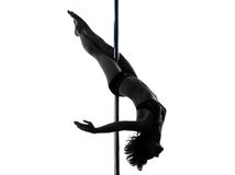 Woman pole dancer crossed knee pose silhouette Royalty Free Stock Photography