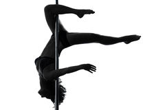 Woman pole dancer scorpion posture silhouette Stock Image