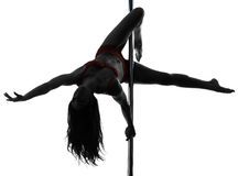 Woman pole dancer silhouette. One caucasian woman pole dancer dancing in silhouette studio  on white background Stock Photos