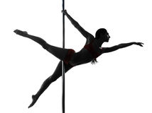Woman pole dancer silhouette. One caucasian woman pole dancer dancing in silhouette studio isolated on white background Royalty Free Stock Photos