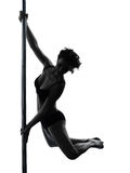 Woman pole dancer silhouette. One caucasian woman pole dancer dancing in silhouette studio isolated on white background Royalty Free Stock Photography