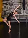 Woman pole dancer Royalty Free Stock Photography