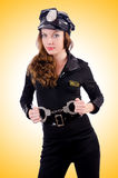 Woman police with handcuffs Stock Images