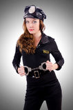 Woman police with handcuffs Stock Photos