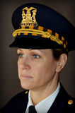 Woman Police Officer. A portrait of a lady police officer in her dress uniform Stock Photos