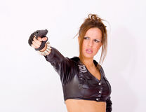 Woman in police uniform holding a gun Royalty Free Stock Image