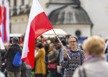 Woman with the Polish flag in the Feast of the Constitution. Young woman with the Polish flag in the Feast of the Constitution Stock Photo