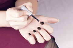 Woman polish her nails Royalty Free Stock Images
