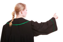 Woman polish lawyer back view pointing direction with finger Royalty Free Stock Photos
