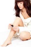 Woman polish nails Royalty Free Stock Image
