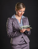 Woman with polish zloty Stock Photos