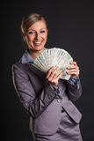 Woman with polish zloty Royalty Free Stock Photography