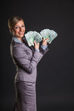 Woman with polish zloty Royalty Free Stock Images