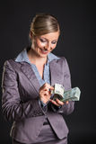 Woman with polish zloty. Money on dark gray background Stock Photography