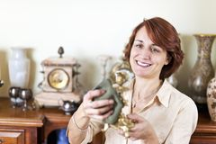 Woman polishing antiques Royalty Free Stock Photo
