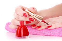 Woman polishing nails Stock Photo
