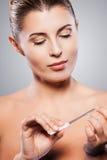 Woman polishing nails. Royalty Free Stock Photography