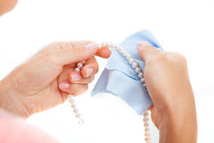 Woman polishing pearls Royalty Free Stock Photos