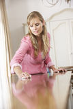 Woman Polishing Table At Home Stock Photos