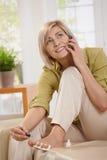 Woman polishing toe nails Royalty Free Stock Images