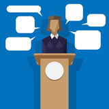 Woman politician behind the podium with speech bubbles Royalty Free Stock Photography
