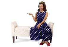 Woman in Polka Dot Dress Presenting Something Royalty Free Stock Images