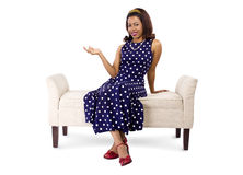 Woman in Polka Dot Dress Presenting Something Royalty Free Stock Photography