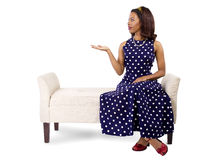 Woman in Polka Dot Dress Presenting Something Stock Images