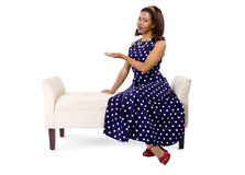 Woman in Polka Dot Dress Presenting Something Stock Photos