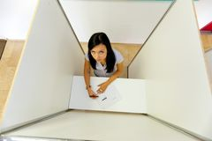 Woman in a polling booth Royalty Free Stock Photography