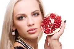Woman and pomegranate Stock Photo
