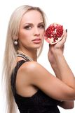 Woman and pomegranate Stock Images
