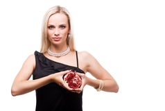 Woman and pomegranate Royalty Free Stock Image