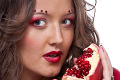 Woman with pomegranate Royalty Free Stock Image