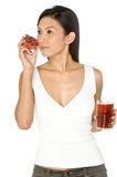 Woman With Pomegranate Juice Stock Image
