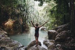 Woman at a pond in the middle of the jungle stock photos
