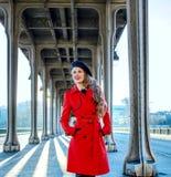 Woman on Pont de Bir-Hakeim bridge looking into distance Royalty Free Stock Image