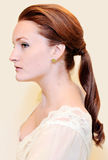 Woman with ponytail. Woman with a low ponytail hairstyle royalty free stock photo