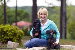 Woman with Poodles Stock Images
