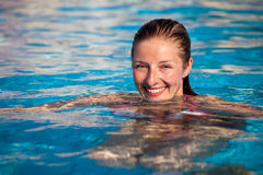 Woman in pool Stock Photos