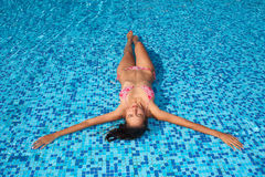 Woman in pool Stock Photos