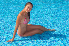 Woman in pool Stock Image