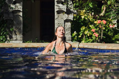 Woman in the pool Royalty Free Stock Photography