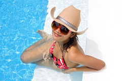Woman in the pool. Young woman in the pool Royalty Free Stock Photography