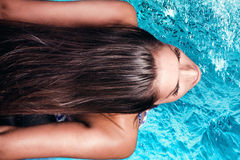 Woman at pool Stock Photography