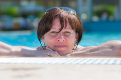Woman in the pool. Middle-aged woman in the pool Stock Photography