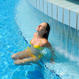 Woman at pool Royalty Free Stock Image