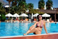 The woman and pool Royalty Free Stock Images