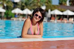 The woman and pool Stock Photography