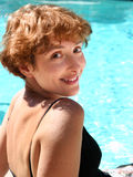 Woman by the pool stock photography